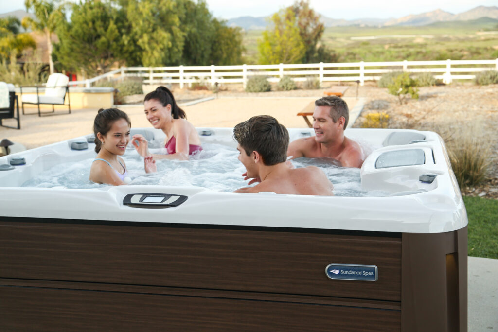 Family enjoying time in their hot tub together.